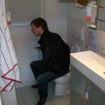 Luuk trying out the toilets in IKEA's bathroom section.