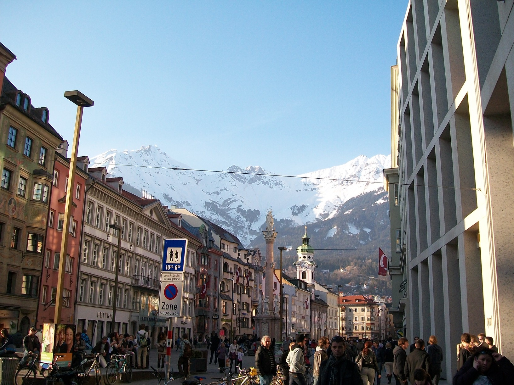 The statue of Jesus in Innsbruck seems to be staring at the massive snowy mountains surrounding Innsbruck. Look at how many people there are outside in the city.