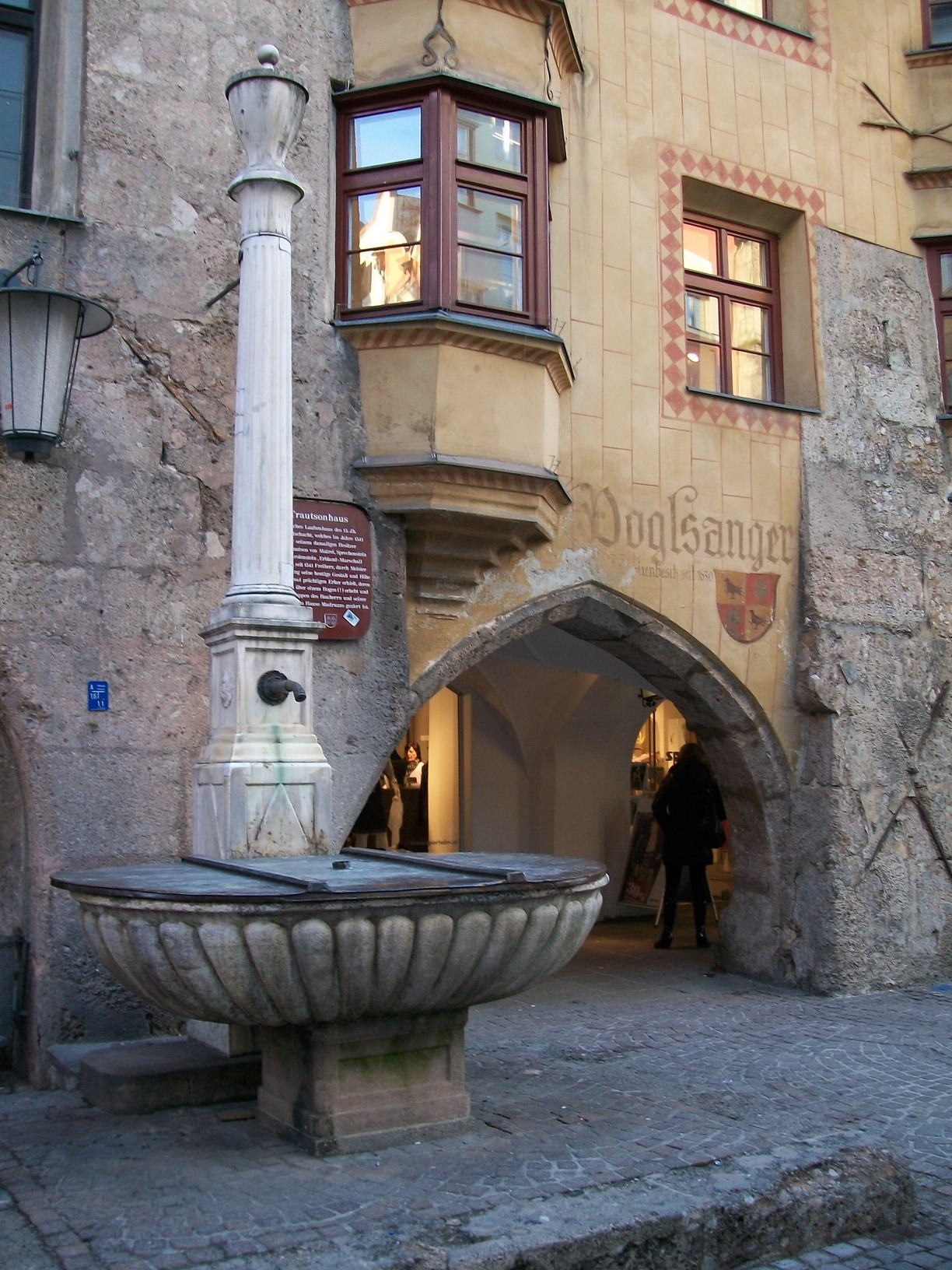 A water fountain outside the entrance to a shop in Innsbruck's Altstad.
