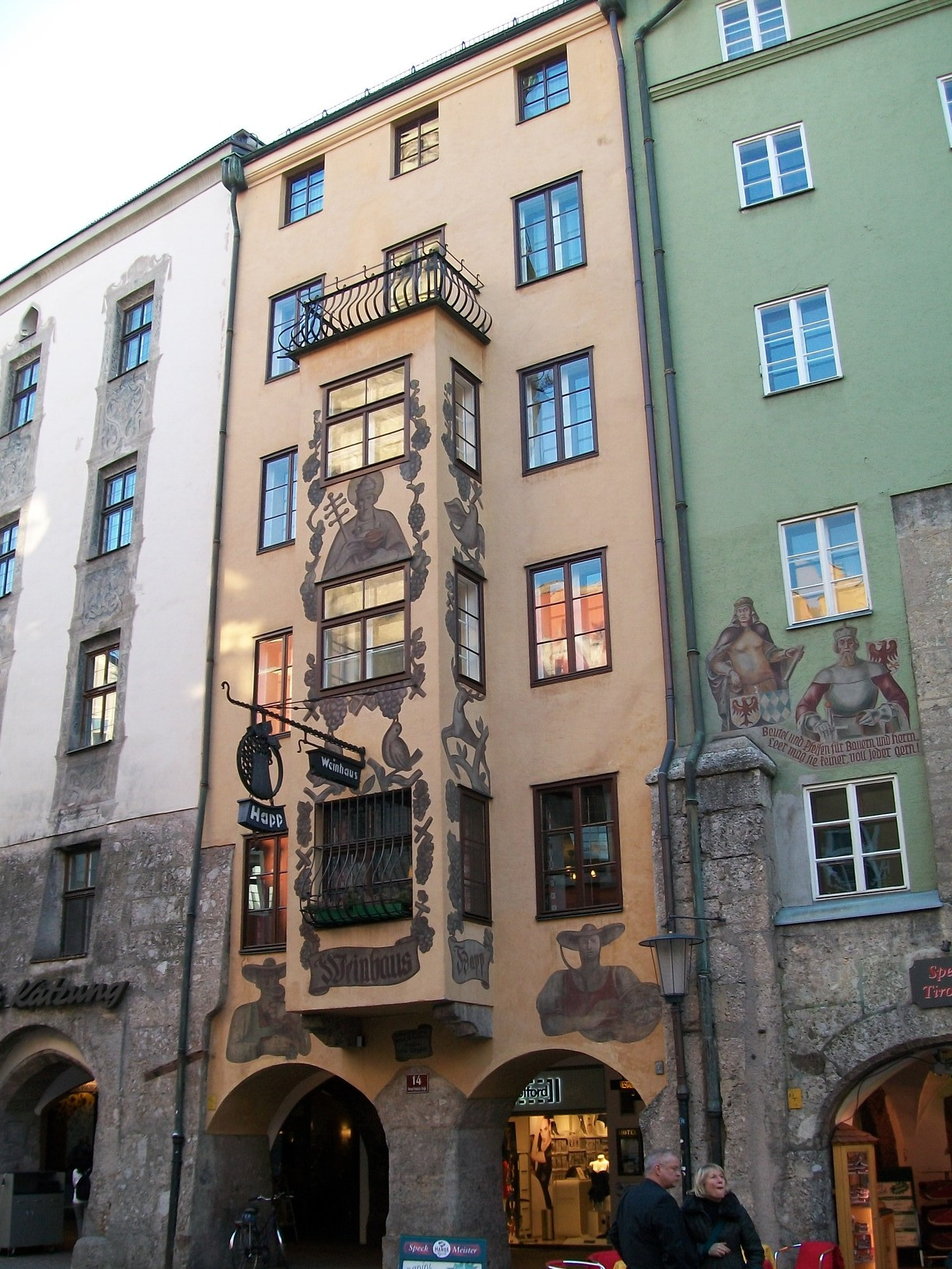 The walls of this building in Altstad are decorated with religious paintings.