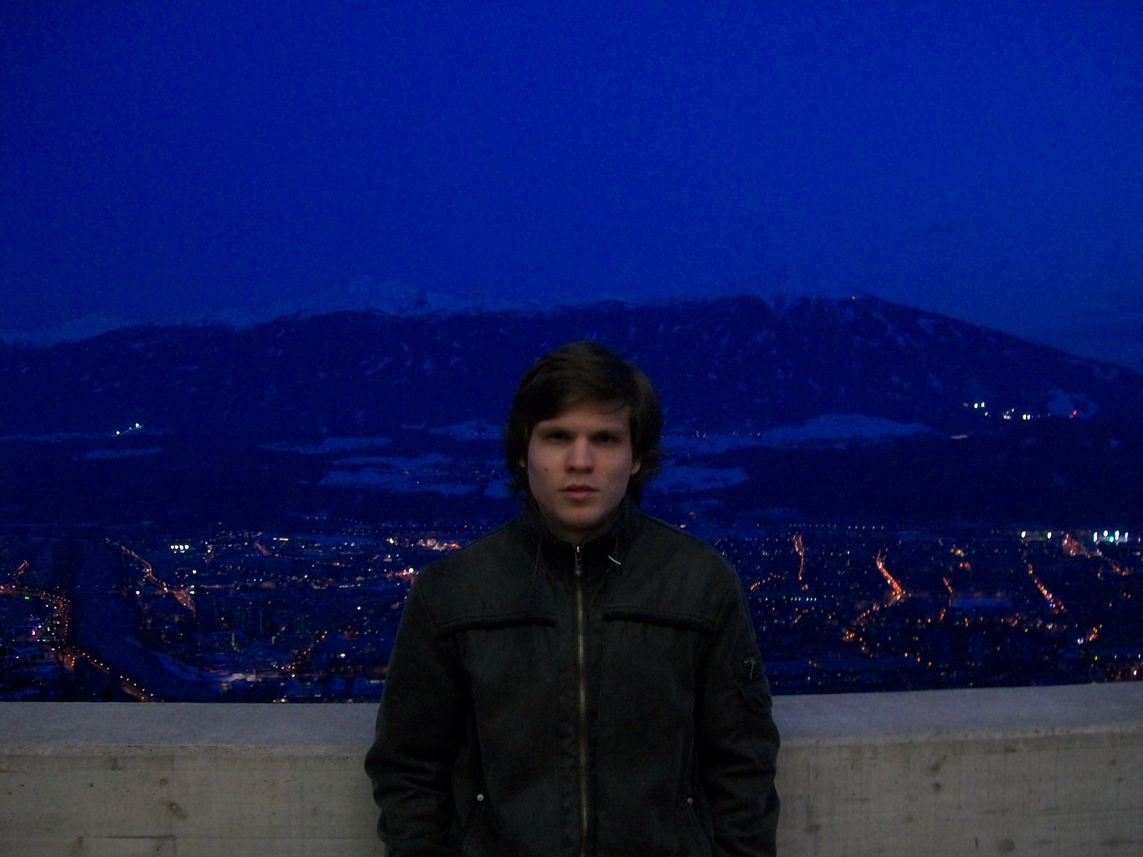 Petr looking cool with a night-view of Innsbruck behind him.