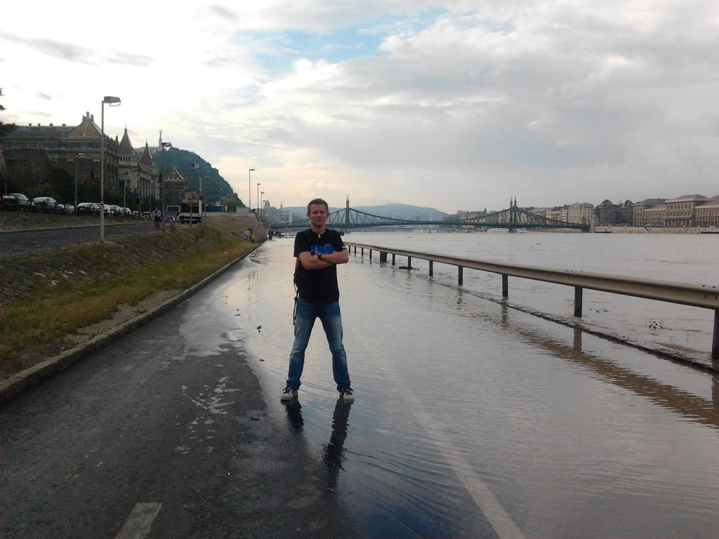 Me, standing on the street near Petőfi bridge with the Danube swirling around my feet.
