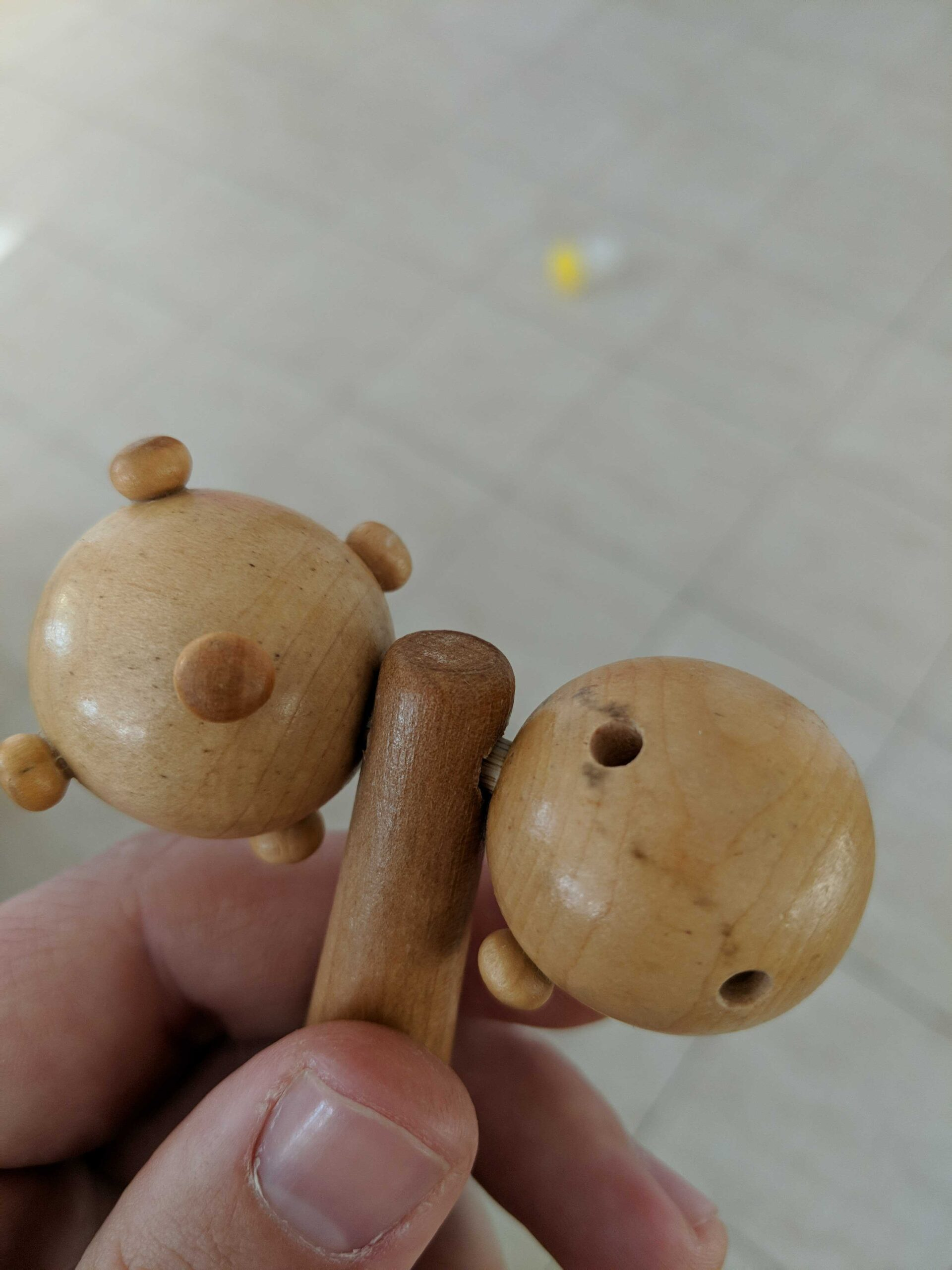 holes from missing knobs in massager