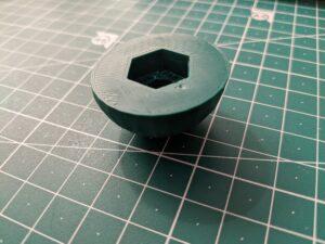 Photo of 3D printed bolt cap