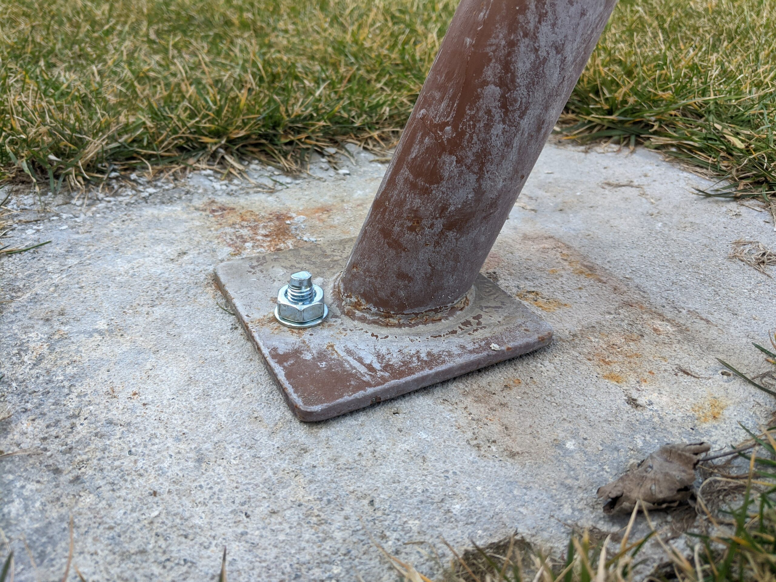 Sharp bolt end protruding from the ground